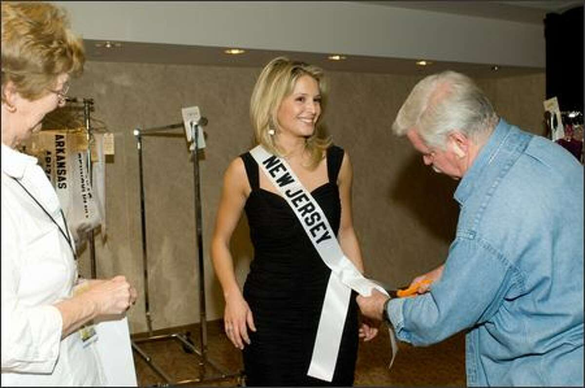 Pete Menefee does a personalized dress fitting with Erin Abrahamson, Miss New Jersey USA 2007.