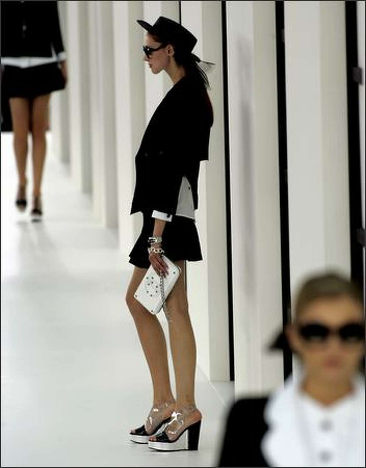 A model presents a creation designed by German fashion designer Karl Lagerfeld for Chanel's spring-summer 2007 ready to wear collection, Friday Oct. 6, 2006 in Paris. (AP Photo/Jacques Brinon)