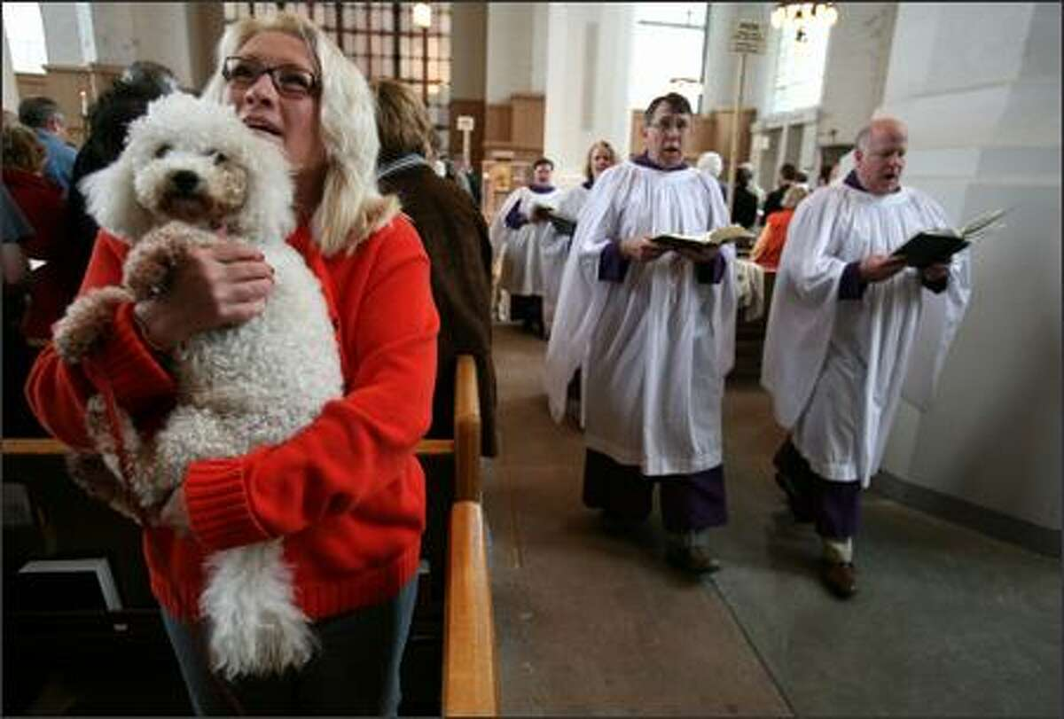 K.C. Botch of Kirkland and Castor, a bichon frise, attend the Blessing of the Animals on St. Francis Sunday at St. Mark's Cathedral. The blessing is a custom done in remembrance of St. Francis of Assisi, who greatly loved animals. day, said Janet Campbell, director of liturgy and the arts at St. Mark's. About 600 people attended three services Sunday.