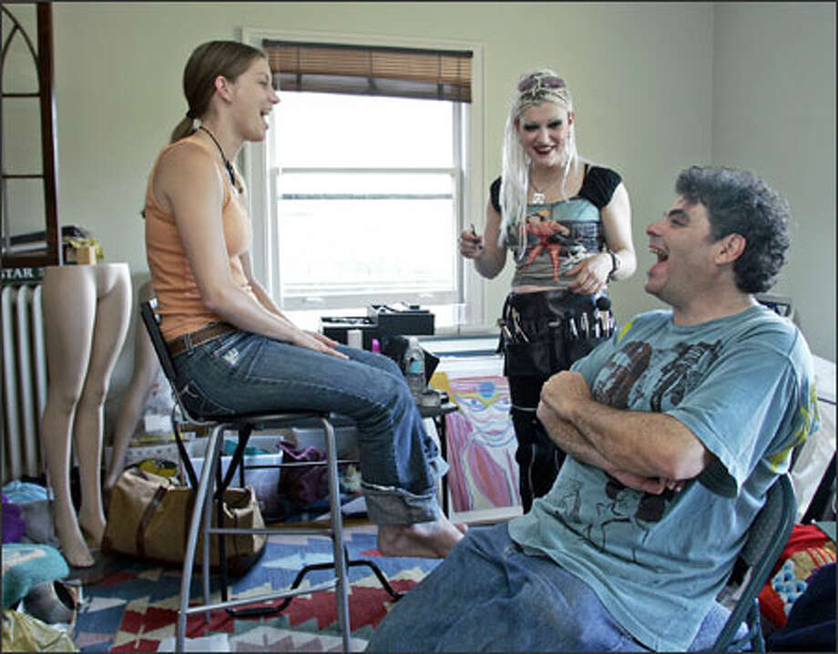 "Actress Jeanette Maus, makeup artist Christina Schock and director David Shulman laugh as they work on the Seattle independent film ""World Enough and Time"" last week. Fewer movies are shooting in Washington, lured away by cash incentives offered in Canada and other states. Photo: / Associated Press / AP"