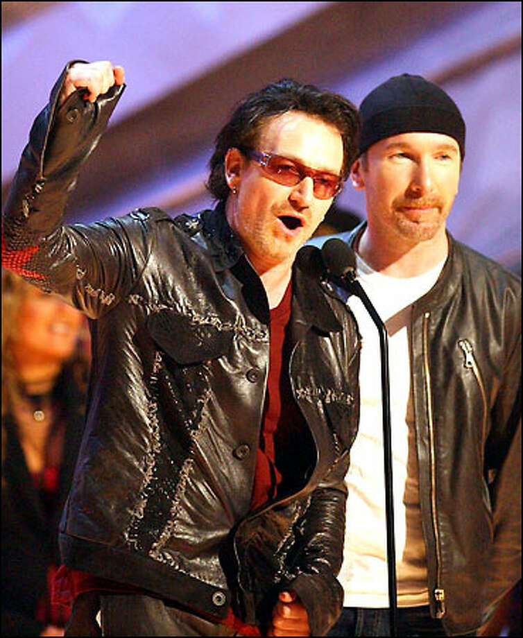 "Bono, left, and The Edge, of U2 accept the award for best rock performance by a duo or group for  ""Elevation"" during the 44th annual Grammy Awards, Wednesday, Feb. 27, 2002, in Los Angeles. Photo: Associated Press"