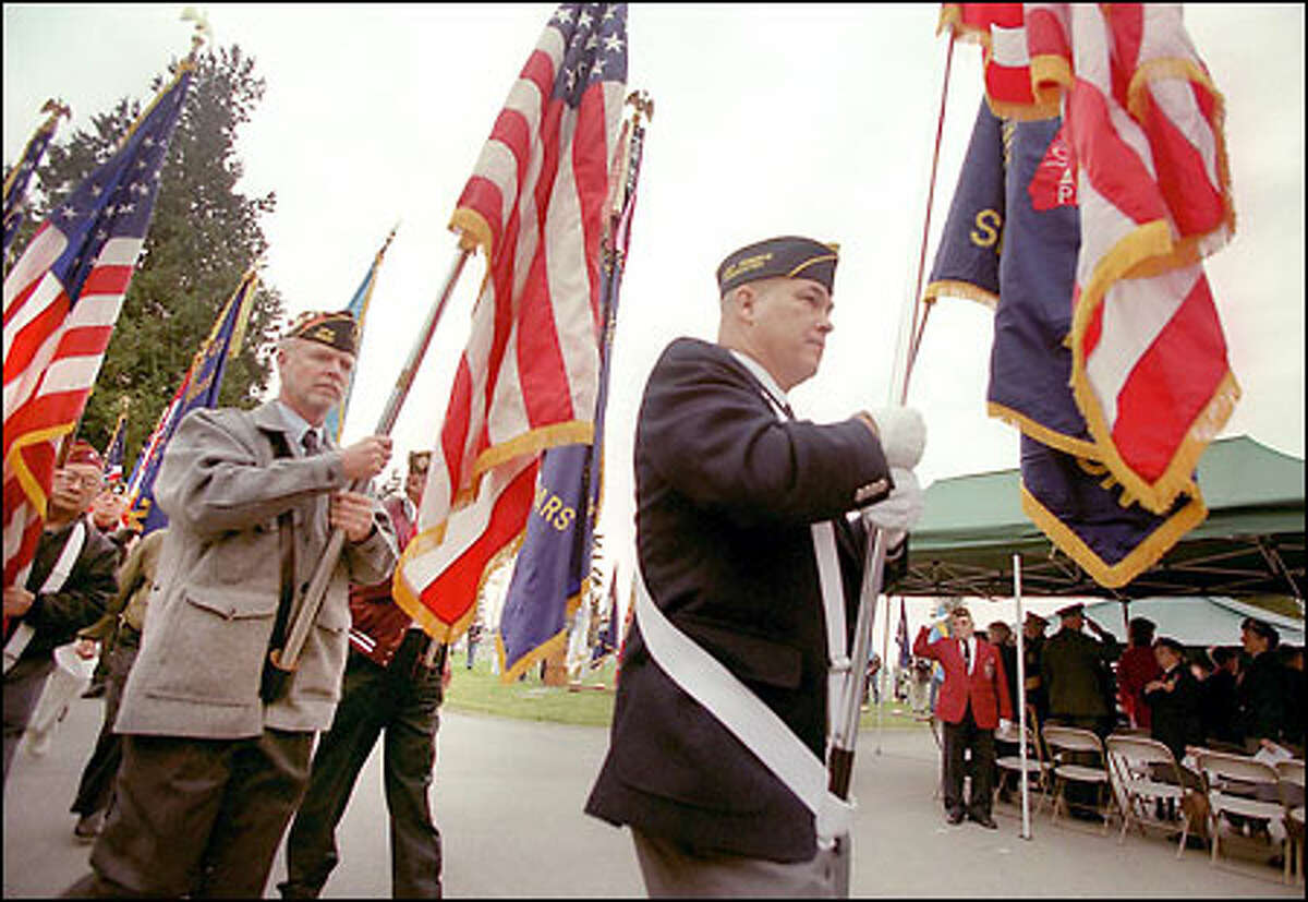 The Parade of Colors starts off Sunday's 52nd Annual Veterans Day Service of Remembrance at Evergreen-Washelli Memorial Park in north Seattle.