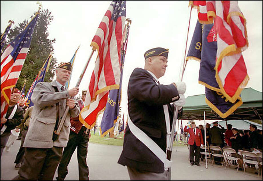 The Parade of Colors starts off Sunday's 52nd Annual Veterans Day Service of Remembrance at Evergreen-Washelli Memorial Park in north Seattle. Photo: Meryl Schenker, Seattle Post-Intelligencer