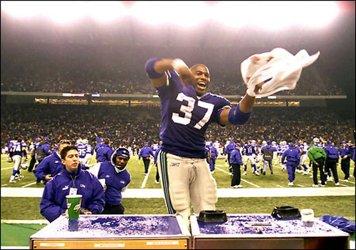 Shaun Alexander rejoices after the Seahawks knocked off the Raiders. The second-year running back shattered franchise records with 266 yards rushing and an 88-yard touchdown run.