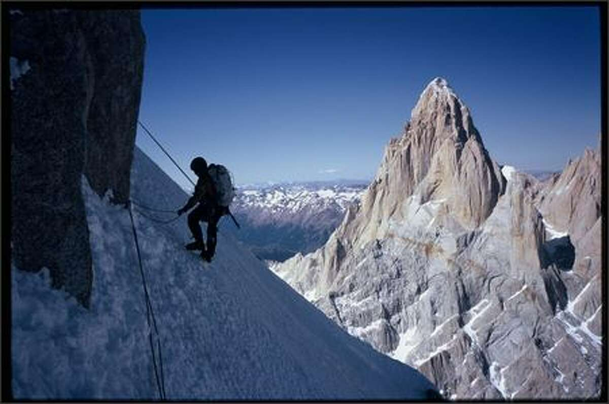 - Kelly Cordes descending Cerro Torre, with Fitz Roy behind. Ptagonia, Argentina. Photo by Colin Haley.