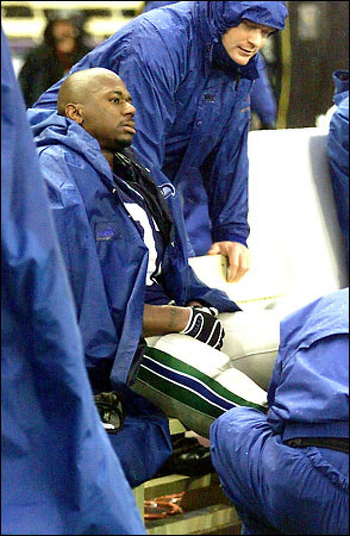 Ricky Watters watches from the bench in the fourth quarter. He's scheduled for an MRI exam today on his injured right ankle.