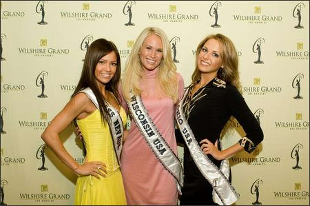 Helen Salas, Miss Nevada USA 2007, Caitlin Shea Morrall, Miss Wisconsin USA 2007, and Anna Melomud, Miss Ohio USA 2007, pose at the Wilshire Grand Hotel in Los Angeles on March 8 before registration and fittings for the Miss USA 2007 competition.