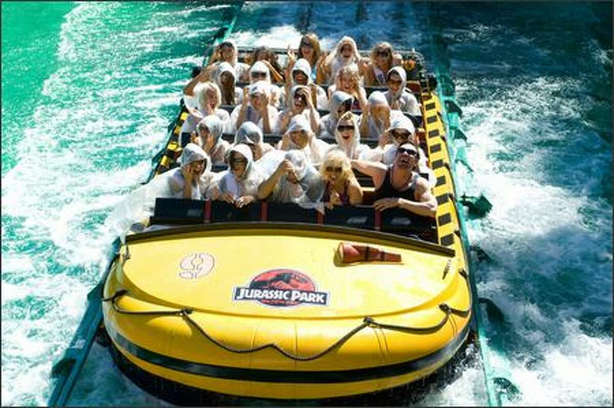 Lauren Elizabeth Barnette, Miss Virginia USA 2007; Keena Bonella, Miss Colorado USA 2007; and Tara Conner, Miss Miss USA 2006, lead a group of contestants on the Jurassic Park ride at Universal Studios in Universal City, Calif., on March 13.