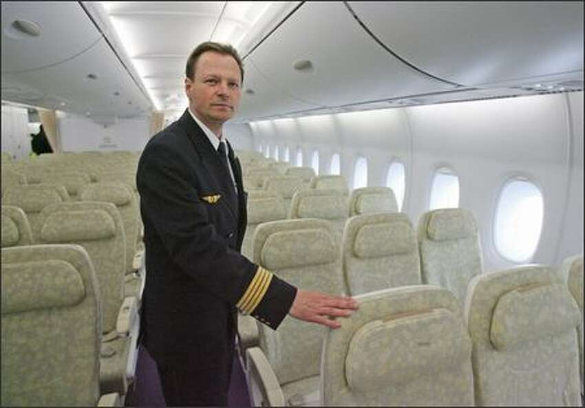 Wolfgang Absmeier, the experimental test pilot for Airbus who flew the Airbus A380 that landed at John F. Kennedy International Airport, gives a tour of the plane's cabin, on Monday, March 19, 2007, in New York. Airbus SAS's 555-seat, double-decker A380, the largest passenger plane ever built, made its U.S. debut today, with planes landing within 18 minutes of each other in New York and Los Angeles.