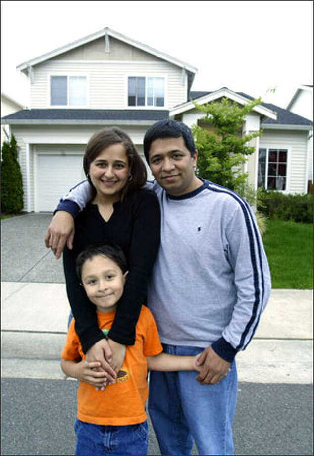 Peeyush and Mallika Ranjan with their 6-year-old son, Ankit, outside their home in Sammamish. Photo: Dan DeLong/Seattle Post-Intelligencer