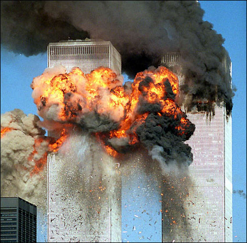 September 11: A fireball erupts from one of the towers of the World Trade Center after it was struck by a hijacked aircraft.