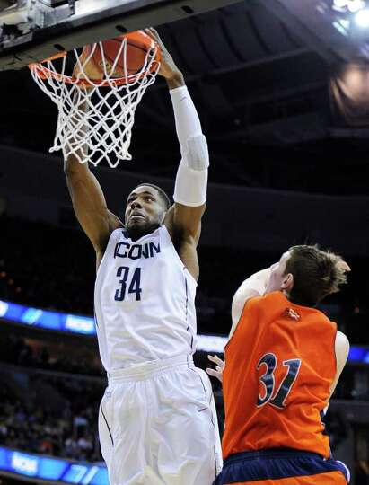 Connecticut forward/center Alex Oriakhi dunks over Bucknell center Mike Muscala during the second ha