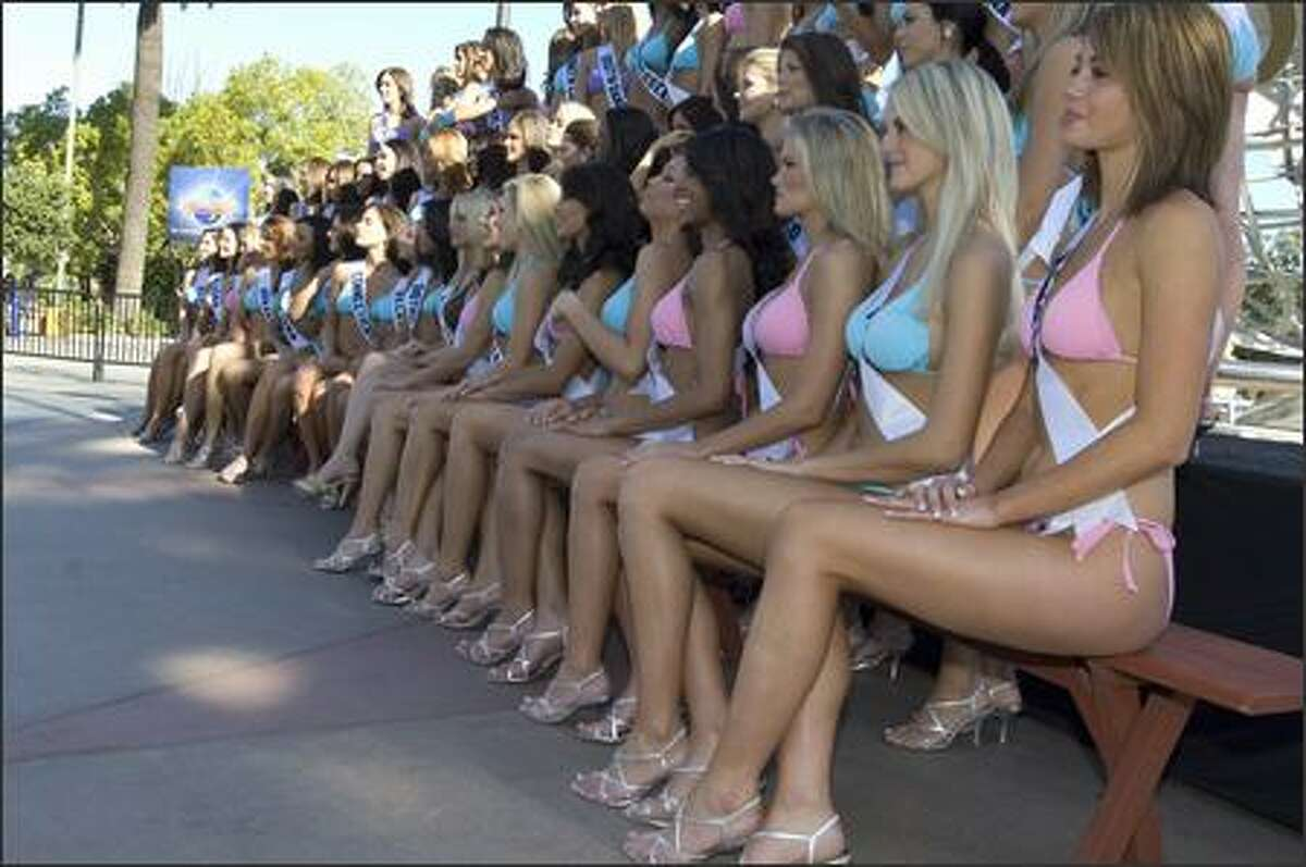 Contestants for the 2007 Miss USA competition line up in their swimwear by BSC Thailand and Nina shoes for a poster shoot at Universal Studios.