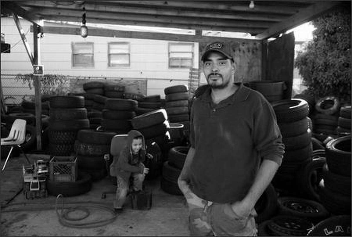 """""""In my country (El Salvador), if you own a business, people come and ask for money. If you don't give it, they kidnap you. I'm so glad with God to be in this country."""" -- Alberto Quintanilla, 30, who owns a used tire business in West Seattle."""