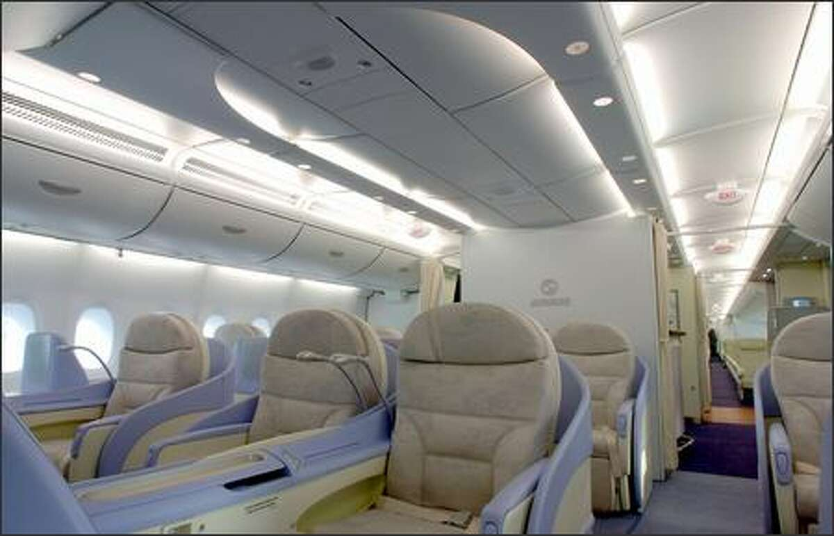 View of the main deck in first class. The development and demonstration cabin of the A380 has 519 seats, with 64 in Business Class and 136 in Economy on the upper deck. The Main deck is configured with 12 First class seats and 307 Economy seats. The A380, which is two years late, will go into passenger service in November of this year with Singapore Airlines. Airbus allowed reporters to fly in its A380 for the first time Wednesday on a flight from the Airbus headquarters in Toulouse, France.
