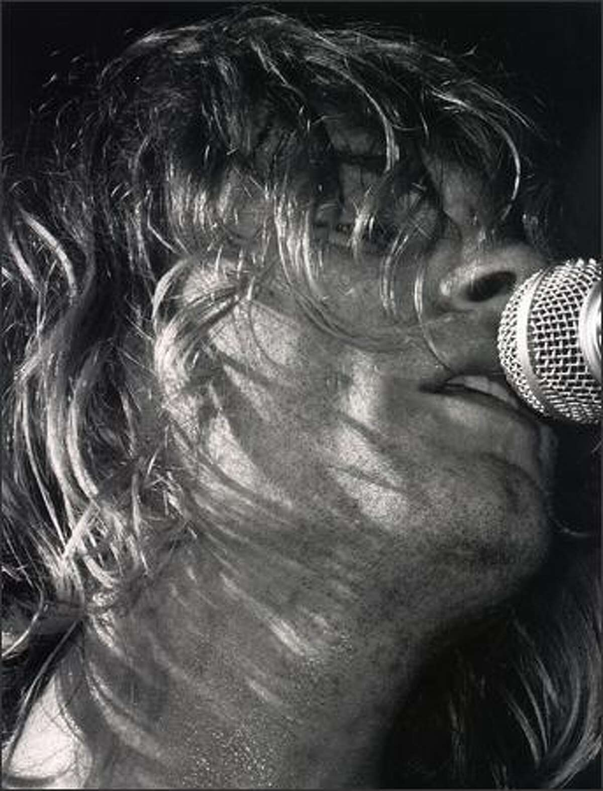 Kurt Cobain sings during Nirvana's concert at the Paramount in Seattle on Halloween 1991.