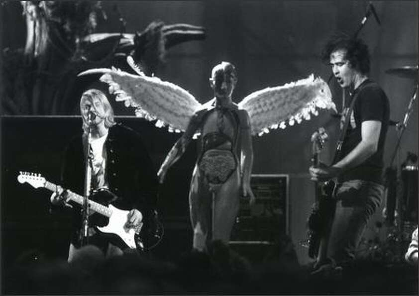 Kurt Cobain, left, and Krist Novoselic perform at Pier 48 in Seattle during a taping of MTV's 1993 N