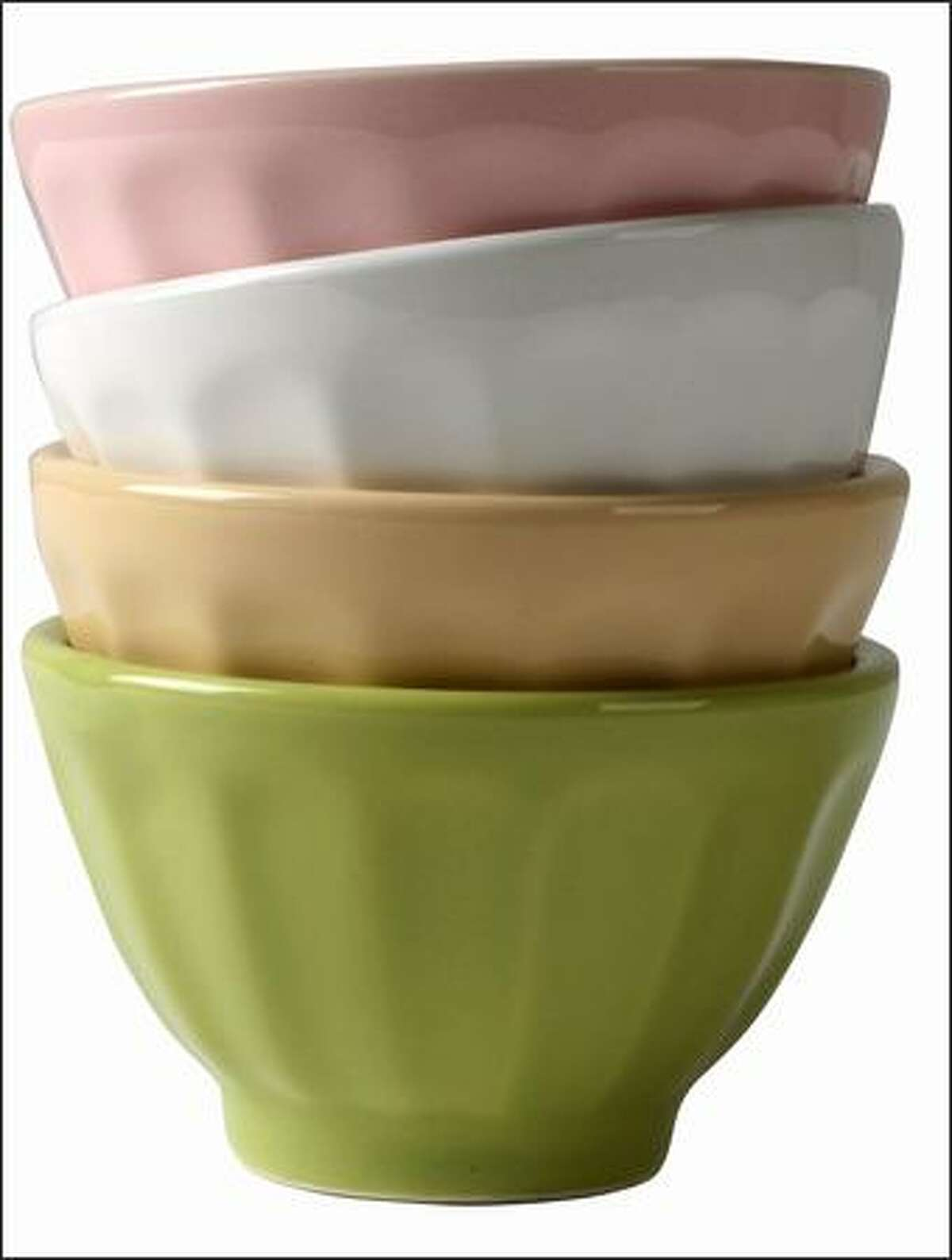 $10 Mini latte bowls I'm smitten with these charming little bowls. Pink, white, yellow, green, blue or chocolate brown. Set of four. From Anthropologie.