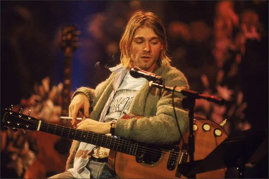 American singer and guitarist Kurt Cobain (1967 - 1994), performs with his group Nirvana at a taping of the television program 'MTV Unplugged,' New York, New York, Novemeber 18, 1993. Photo: Getty Images