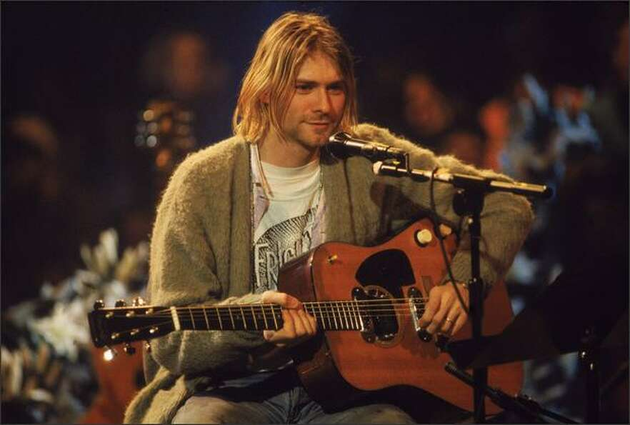 Singer and guitarist Kurt Cobain performs with his group Nirvana at a taping of the television progr