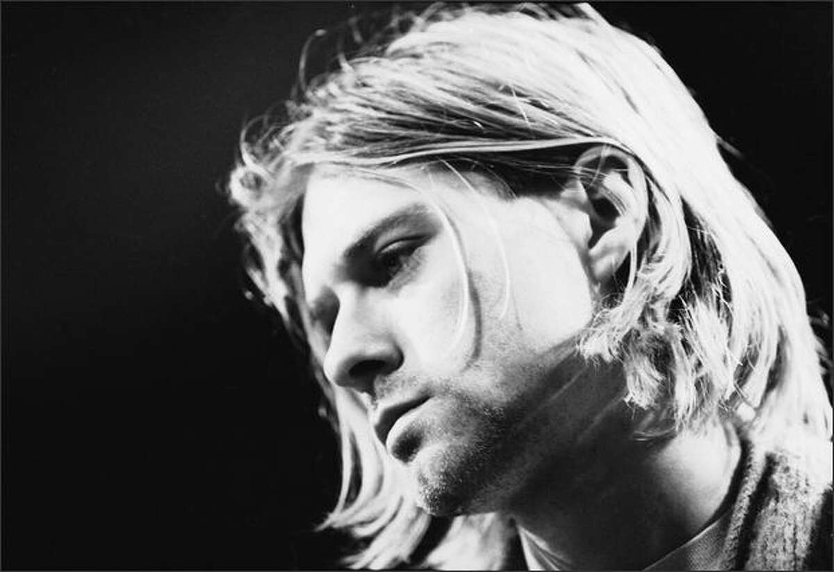 Singer and guitarist Kurt Cobain performs with his group Nirvana at a taping of the television program 'MTV Unplugged,' New York, New York, Novemeber 18, 1993.