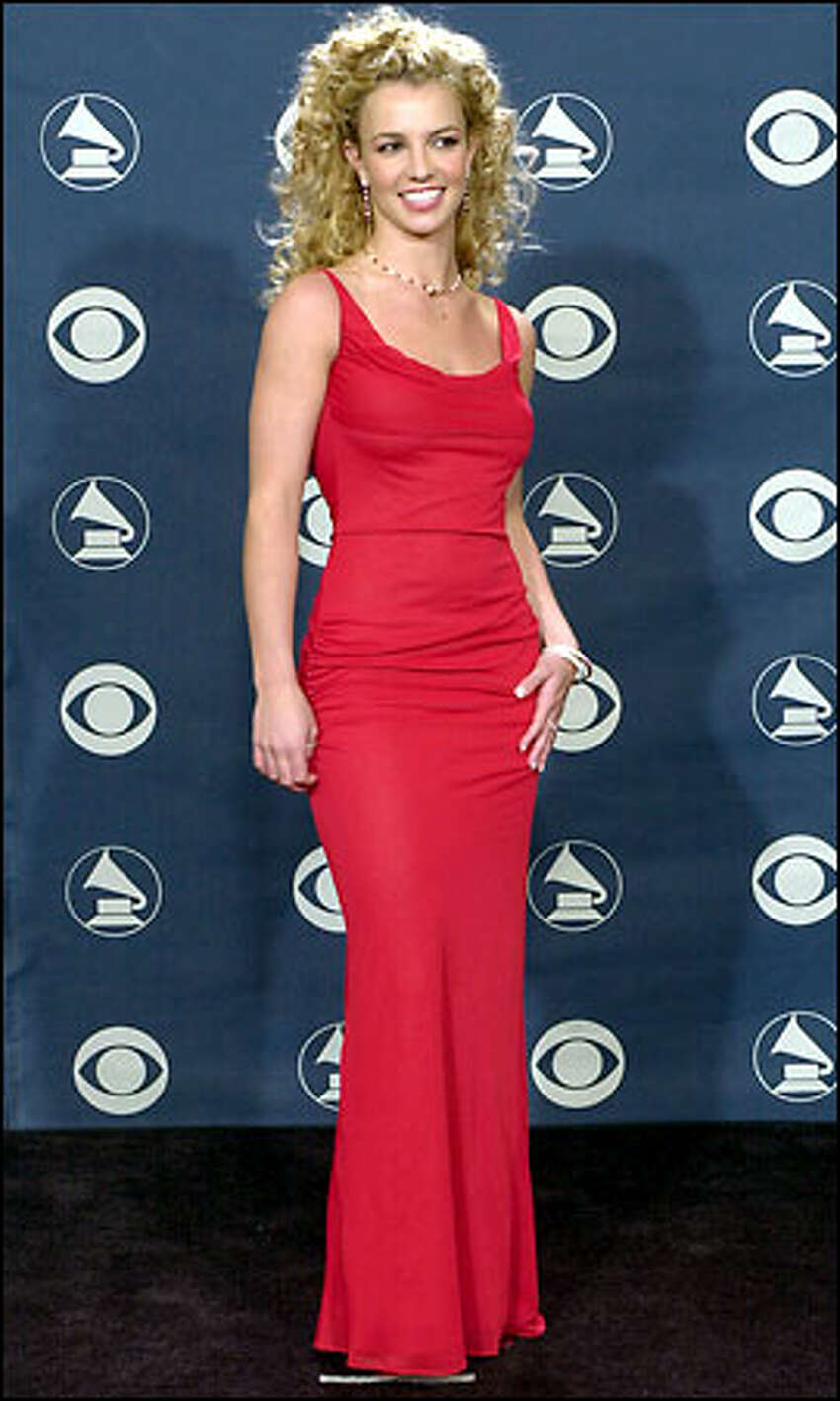 Britney Spears poses after presenting an award during the 44th annual Grammy Awards in Los Angeles.