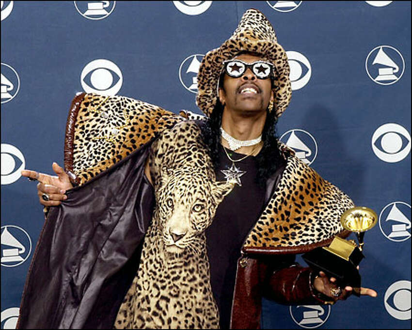 Bootsy Collins shows off his Grammy after winning for best short form music video for his performance in Fat Boy Slim's