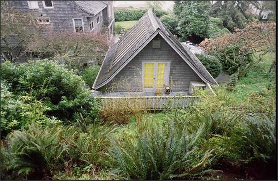 Kurt Cobain's body was found in a greenhouse above the garage of his home in the Madrona area. The greenhouse was demolished in 1996. Photo: Phil H. Webber, Seattle Post-Intelligencer