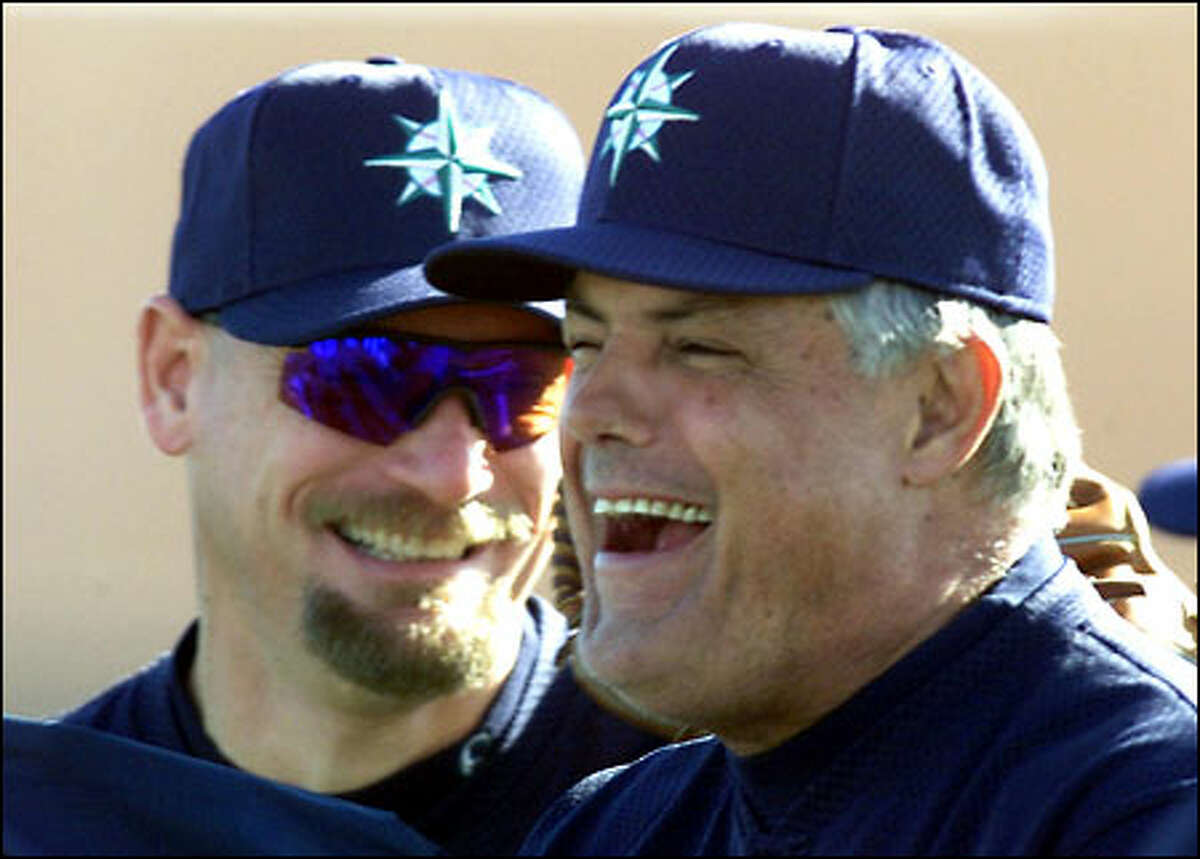 Mariners manager Lou Piniella laughs it up with new coach Jay Buhner during practice in Peoria, Arizona.