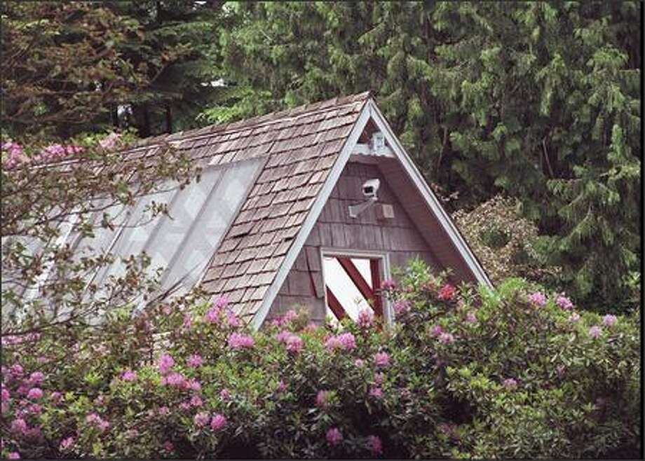 A June 1996 photo of the greenhouse where Kurt Cobain shot himself. Photo: Phil H. Webber, Seattle Post-Intelligencer
