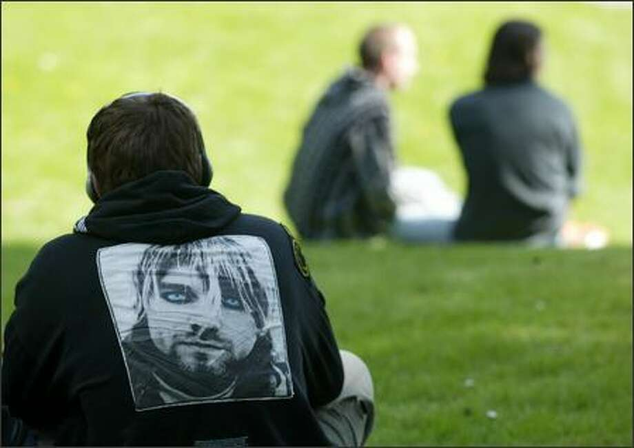 Justin Sevier wears a jacket with the image of Kurt Cobain at Viretta Park on April 5, 2004. He and dozens of fans gathered at the small park next door to Cobain's former home to mark the 10-year anniversary of the singer's death. Sevier fasted until April 8, a decade after the day an electrician discovered the date Cobain's body. Photo: Mike Urban, Seattle Post-Intelligencer