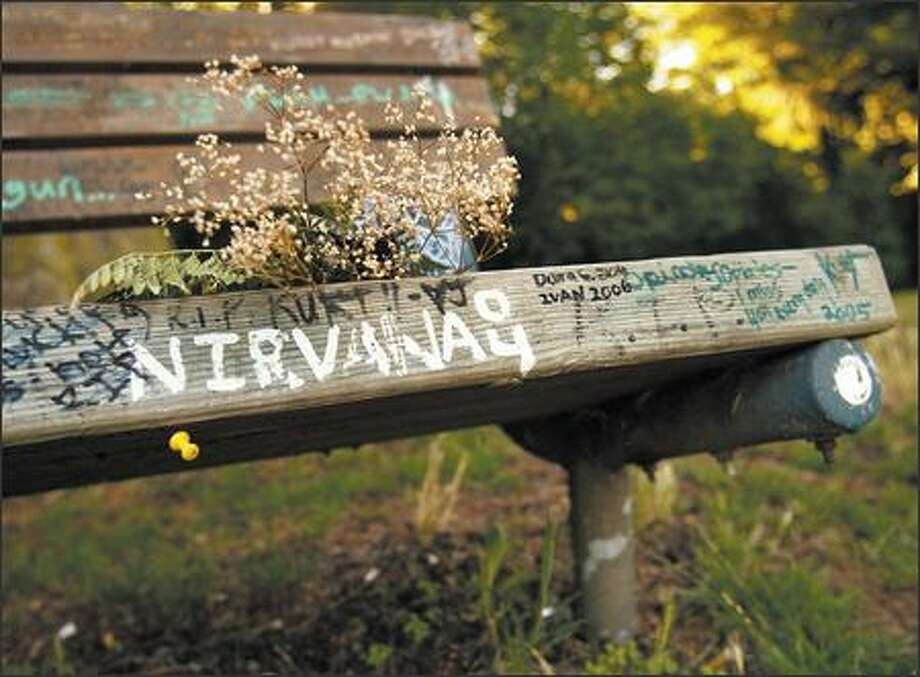 The bench next to the site of Kurt Cobain's death is marked with notes to the singer who committed suicide. Photo: Joshua Trujillo, Seattlepi.com