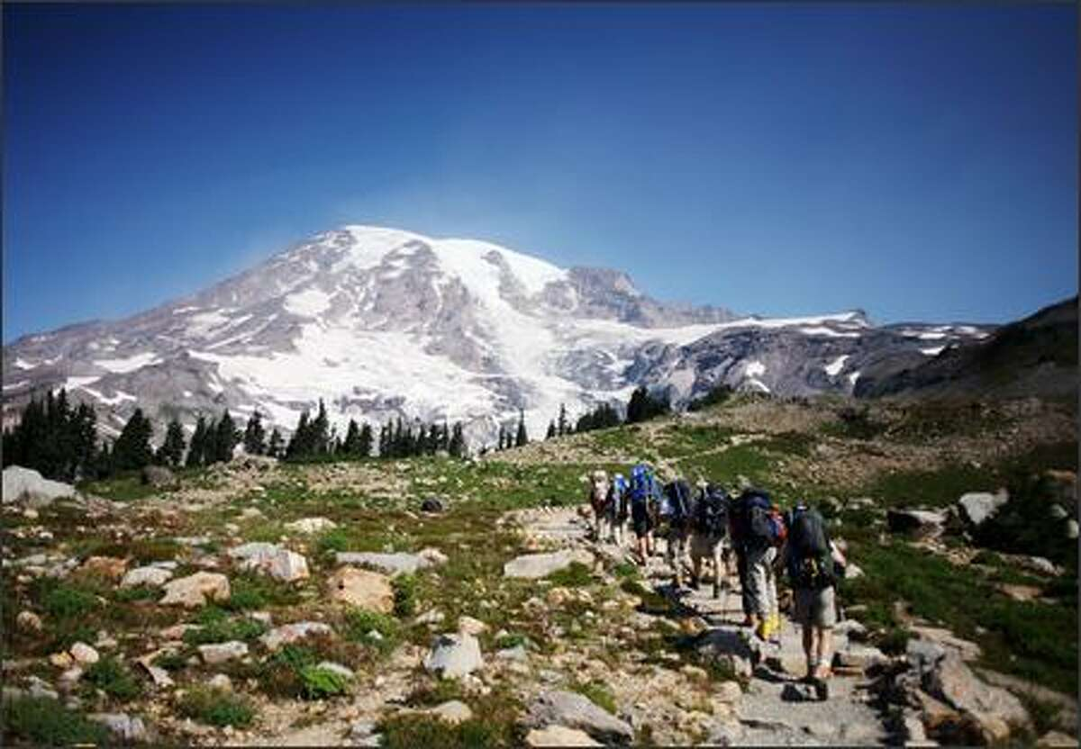 Climbers head out from Paradise, then a summit attempt, on their way to Camp Muir on Tuesday, August 22, 2006.