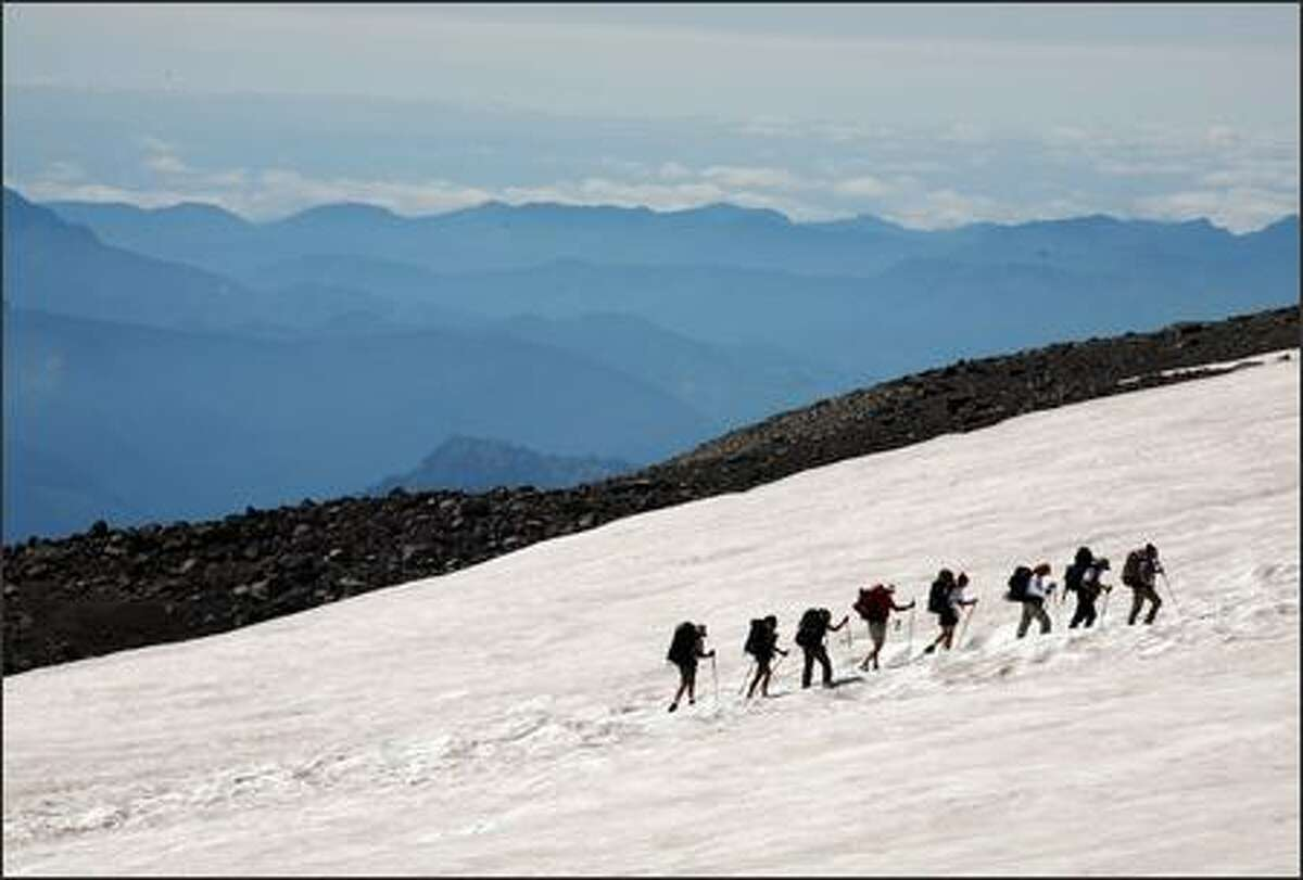 Climbers head up from Paradise to Camp Muir on the first day of a two-day summit attempt of Mt. Rainier on Tuesday, August 22, 2006.