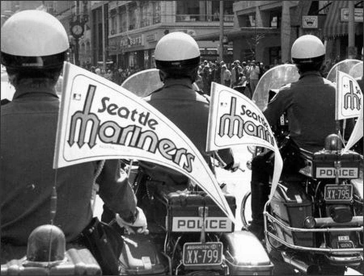 Seattle Police flew Mariners pennants during a parade down Fourth Avenue before the inaugural game on April 6, 1977. (Howard Staples, P-I/1977)
