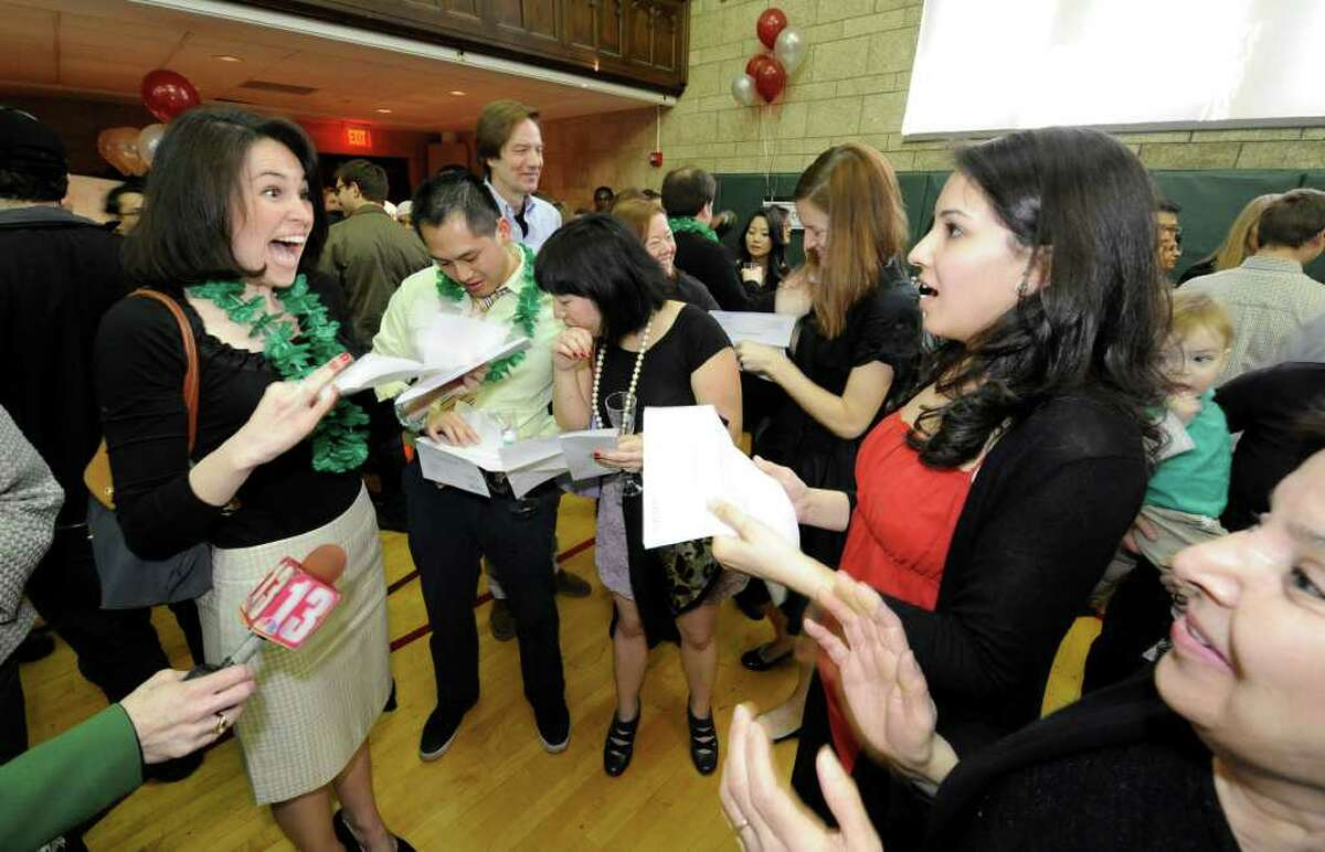 """Fourth-year medical students from the Albany Medical College celebrate after receiving their first choices for their residency in the Albany Law School gym on """"Match Day 2011"""" in Albany, New York March 17, 2011. (Skip Dickstein / Times Union)"""