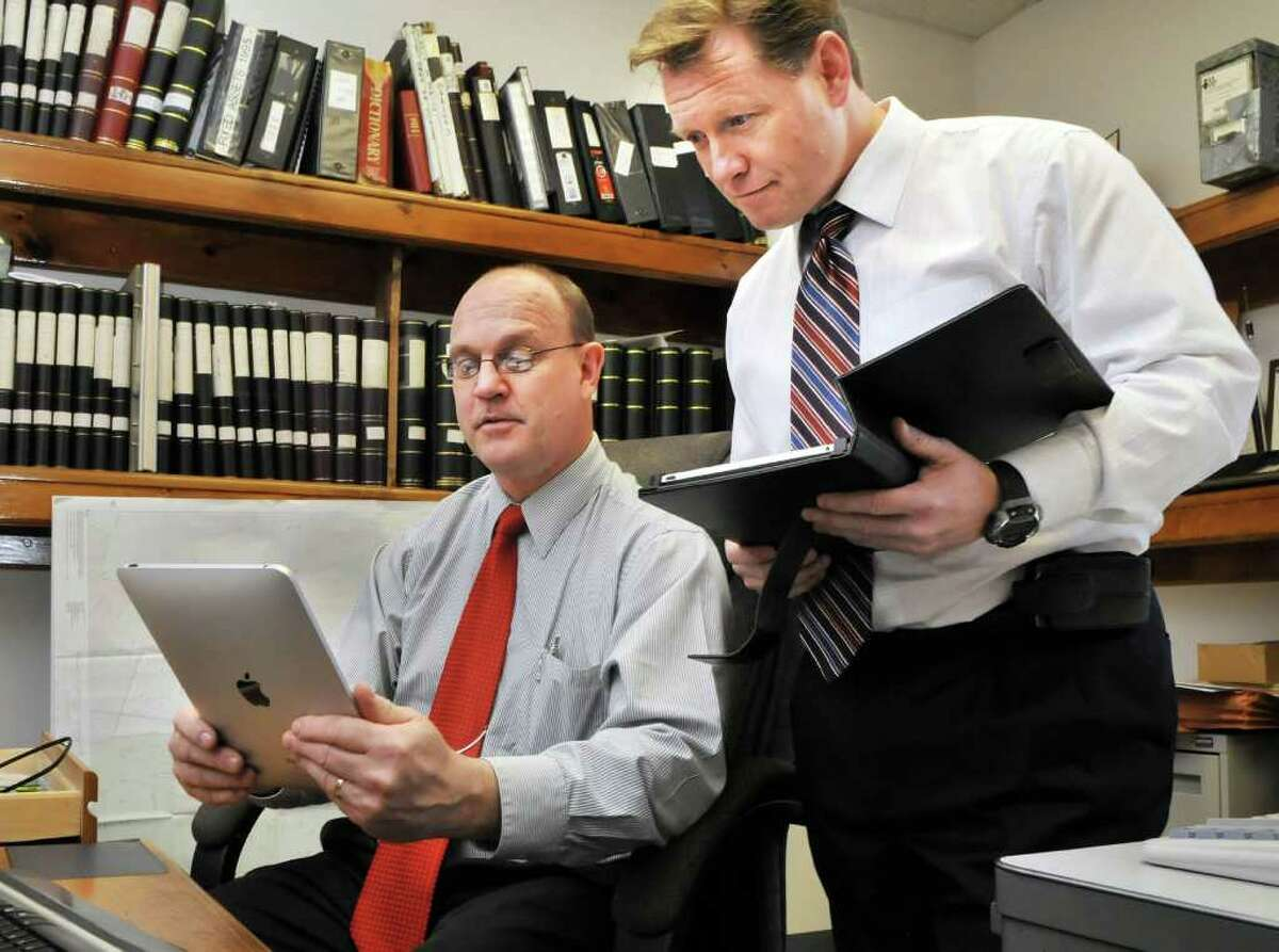 Watervliet City Clerk Bruce A. Hidley, left, and Mayor Michael P. Manning use their iPads at City Hall. About 12 city employees have the tablets as part of effort to reduce paper and improve government workability. (John Carl D'Annibale / Times Union)