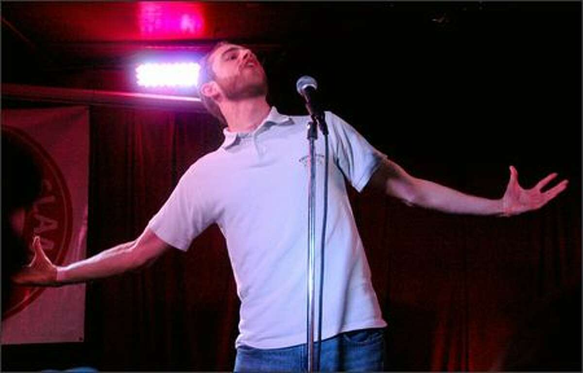 Ryler Dustin, a contestant, performs during the Seattle Poetry Slam's 2007 Grand Slam on Sunday night at Chop Suey. Seattle's top four slam poets selected at the event, which capped the Seattle Poetry Festival, will compete in the national slam competition August in Austin, Texas.