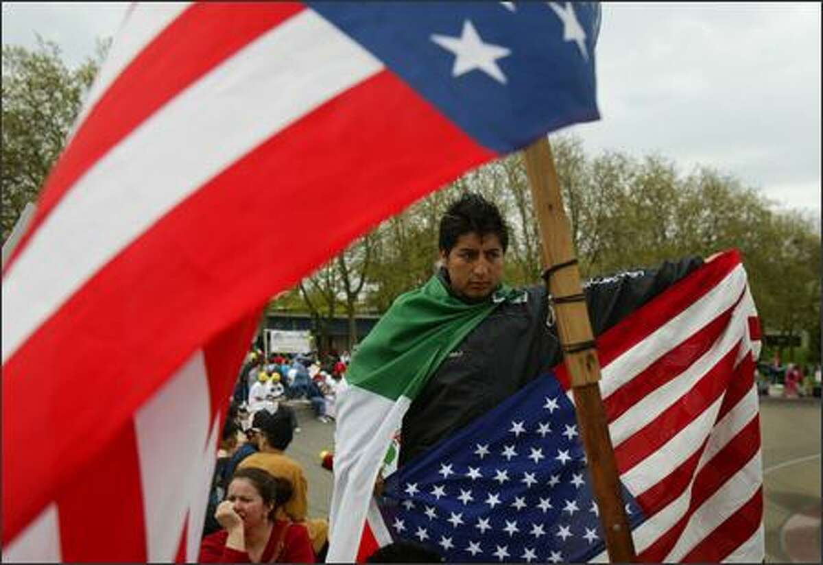 Rodolfo Alvarez, who has been in the U.S. for 1 year, prepares to march with a few thousand immigration protesters at the Seattle Center on Tuesday May 1, 2007 in Seattle.