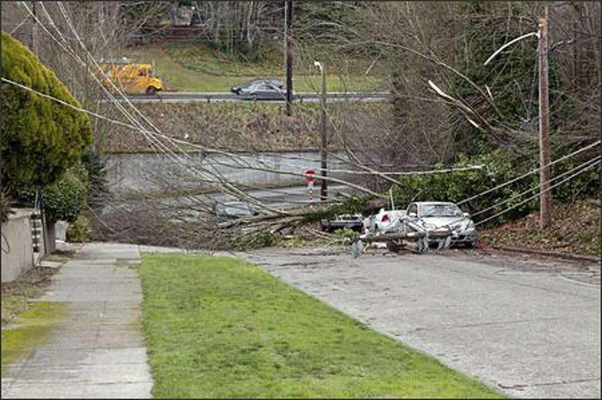 Willam Anthony, a reader on the west side of Seattle's Queen Anne Hill neighborhood submitted this photo. He said his house lost power overnight, joining many other residents and businesses who were still coping with outages Friday. The photo is of downed power lines near the intersection of Third Avenue West and West Barrett Street.
