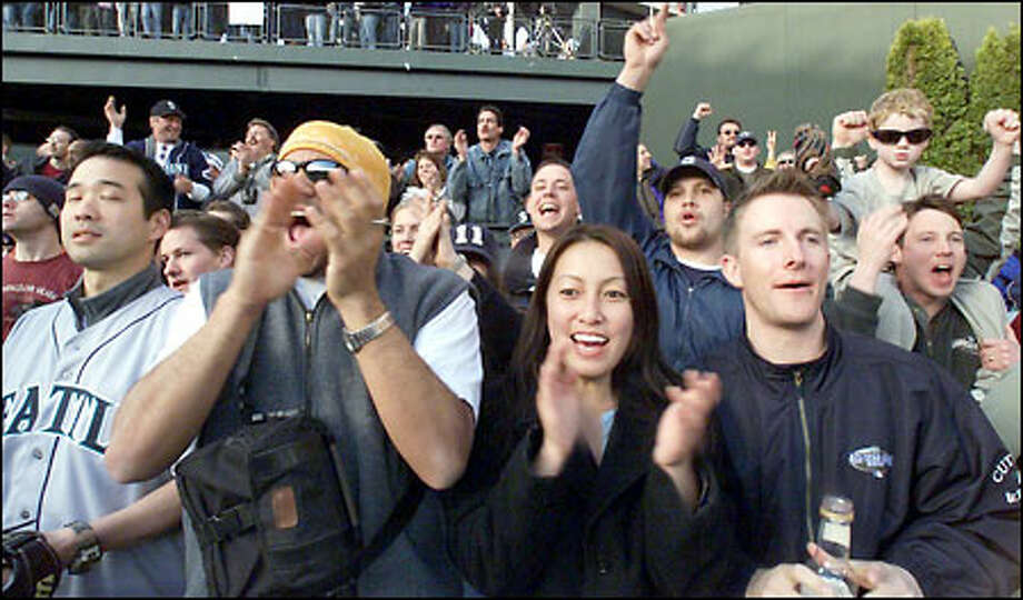 Opening Day fans react to Mariners in the eigth, from left, in front row: Rich Mar, Tom Dos Remedios, Thy Tran and Ryan Nolz react to Mariners when they made it 5-6 in eighth inning. Photo: Grant M. Haller, Seattle Post-Intelligencer