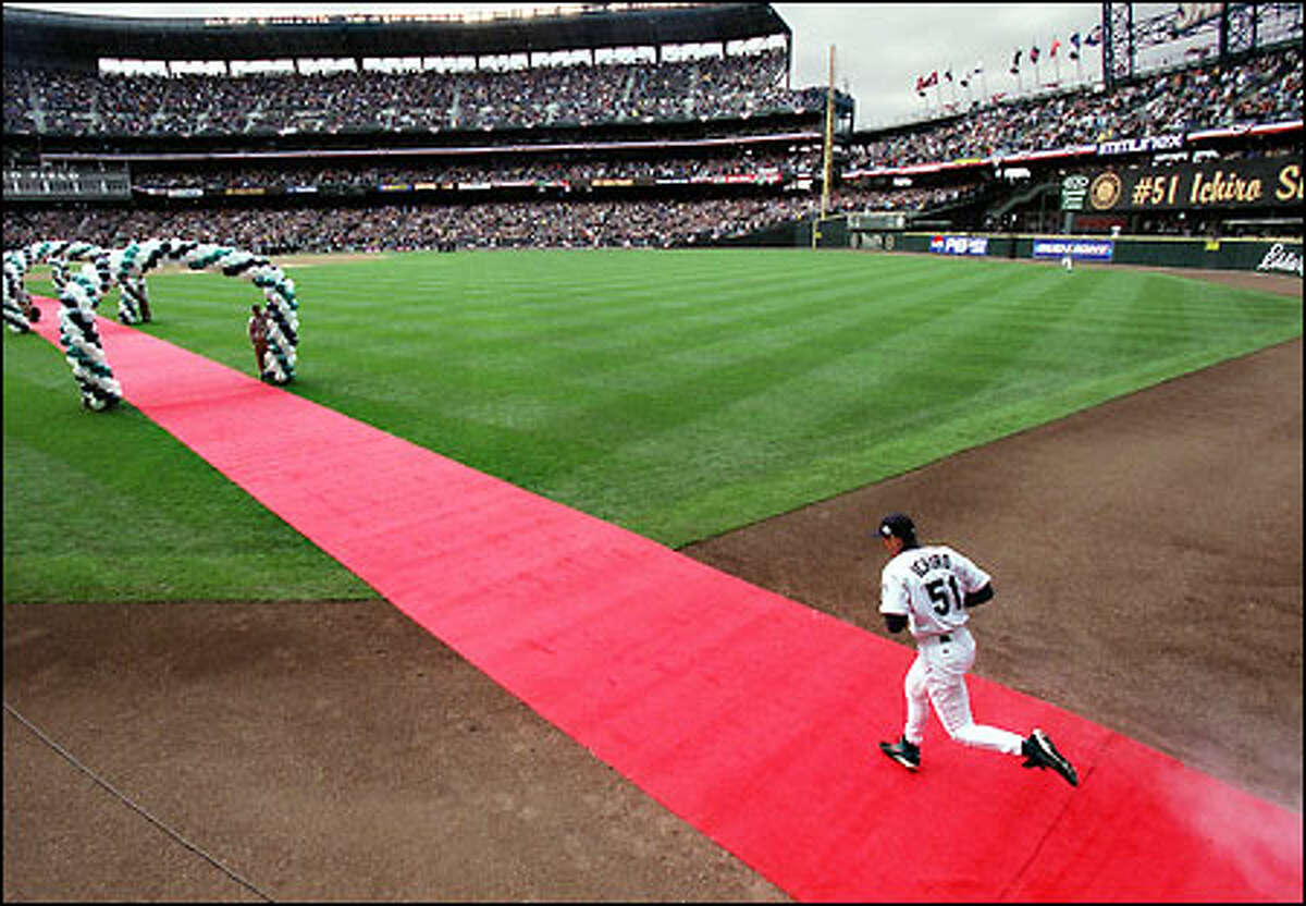 Ichiro takes the field in the Mariners opening game of the 2002 season.