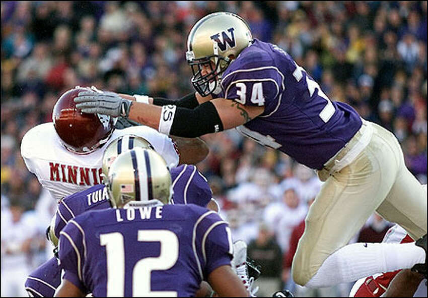 Washington's Greg Carothers stops WSU Dave Minnich on a 4th and goal on the one yard line in the 1st quater.
