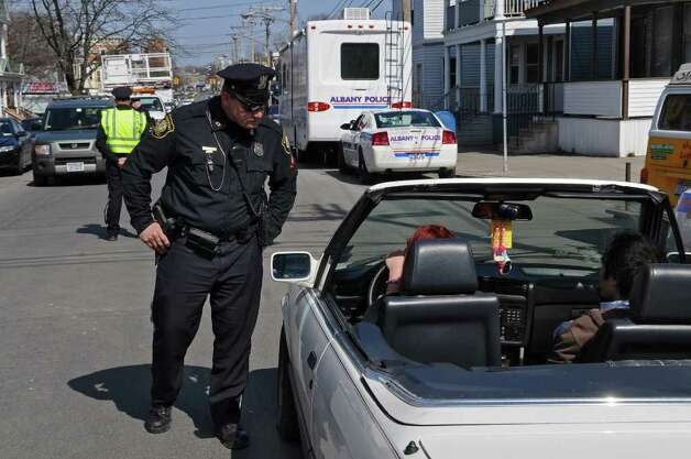 Albany police officers conduct traffic checks on Quail Street at the intersection of Hudson Avenue on Thursday March 17, 2011 in Albany, NY.   They were there as part of a stepped up police presence in the neighborhood following a street melee involving students there earlier this week. ( Philip Kamrass/ Times Union ) Photo: Philip Kamrass