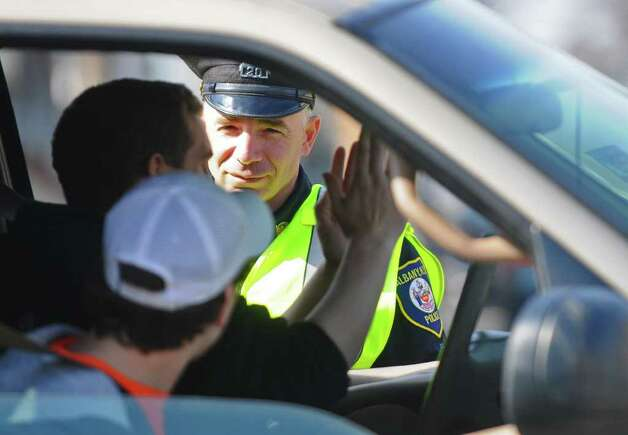 Albany Police Officer William Wilson talks to a driver stopped on Quail Street at the intersection of Hudson Avenue  on Thursday, March 17, 2011, in Albany, NY.   He and other officers were there as part of a stepped-up police presence in the neighborhood following a street melee involving students there Saturday. ( Philip Kamrass/ Times Union ) Photo: Philip Kamrass