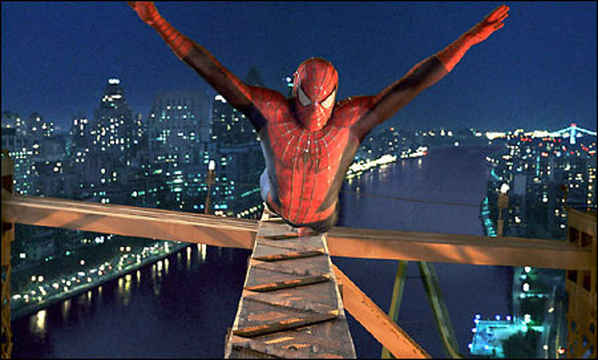 Spider-Man (Tobey Maguire) leaps into action.