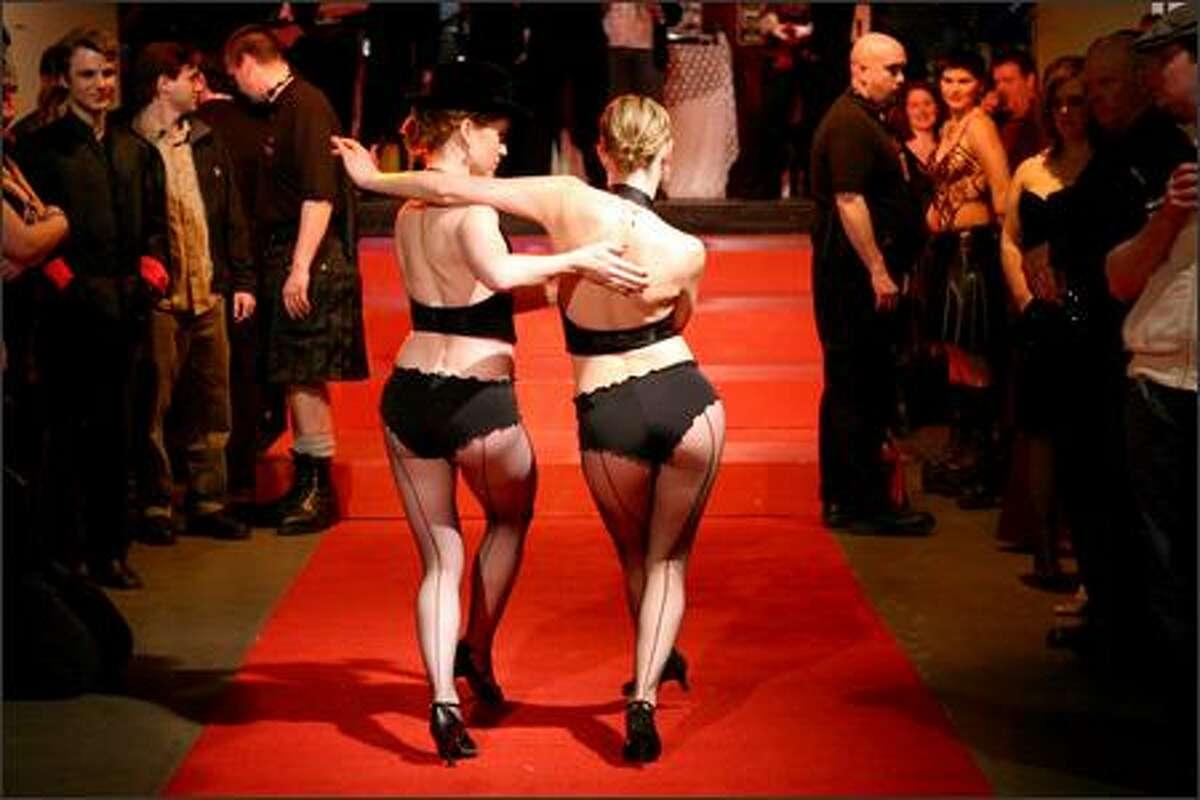 Tango dancers Katie Lake, left, and Sara Thompson perform.