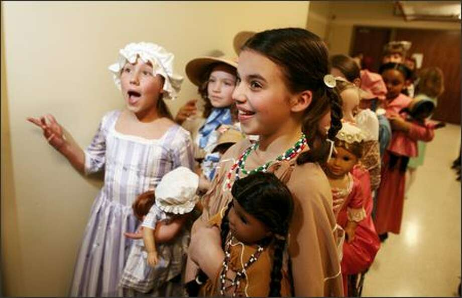 Hayley Miller (left) dressed as the doll Felicity 1 and Malia Cook-Winn (right) dressed as the doll Kaya get ready to go on stage for the American Girl fashion show to benefit Seattle Children's Hospital held at the Westin Hotel in Bellevue on Friday March 16, 2007. Photo: Scott Eklund, Seattle Post-Intelligencer