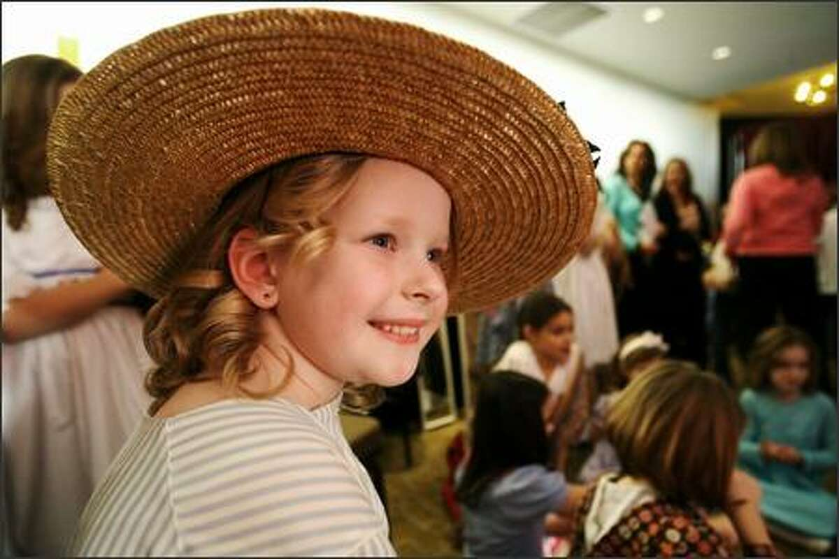 Kelsey Rosholt sports a straw hat as part of her Kirsten 2 outfit during the American Girl fashion show to benefit Seattle Children's Hospital held at the Westin Hotel in Bellevue on Friday March 16, 2007.
