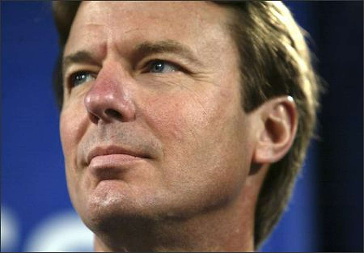 Democratic presidential candidate and former senator John Edwards listens to comments during a town hall style meeting organized by the AFL-CIO Tuesday, May 1, 2007 in Seattle.